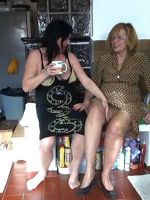 Young and old lesbians pushing sextoys deep in their wet pussies