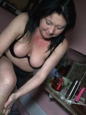 Horny mature lesbians busy by using their sextoys to fuck her pussies