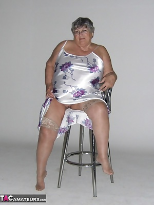 Hot lights in a studio, a satin chemise, a chair to pose on and a keen amateur photographer needing to practice his skil
