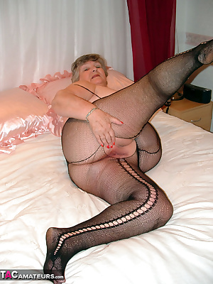 Wearing my sexy black body-stocking makes me really horny.  Watch me fill both my holes with toys ..