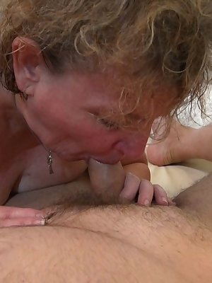 Blonde mature licking and sucking on a fat dick