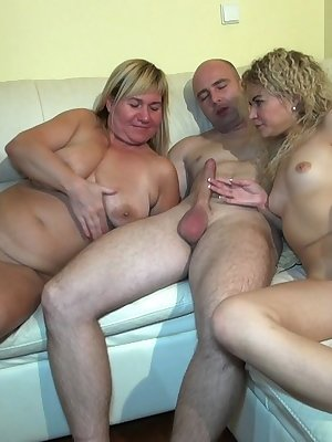 Young girl and mature woman enjoy getting the dick hard to take a ride on it