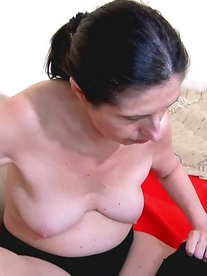 Older lesbian women playing with kinky toys