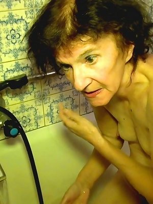 90 year old granny having shower accompanied with hot redhead
