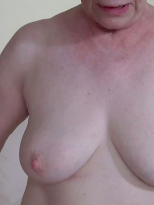 Gorgeous blonde granny trying her big dildo