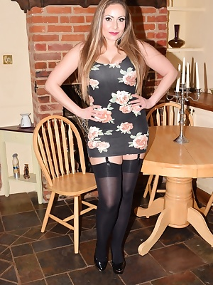 Pictures of Sophia Delane in the parlour in her short flower dress, stockings and suspender and black high heal stiletto
