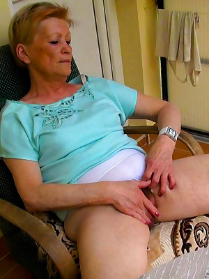 Cute old women rubbing her clit outdoors