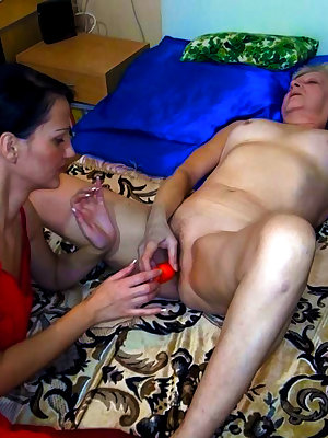 Blonde grandma playing with her hairy pussy