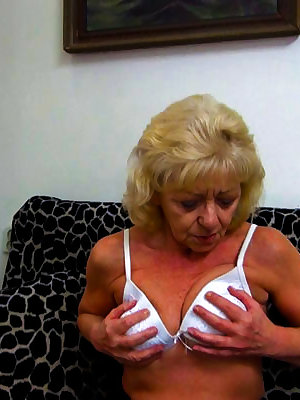 Naughty blonde grandma fucking her pussy with a dildo