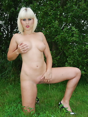 Brittany, stripping full nude outdoors in nature. She is only wearing her high heel shoes when she is showing her wonder