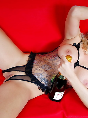 Blonde Sharon likes a good party with champagne and a hot striptease show.Sharon spreads her legs wide open and is expos
