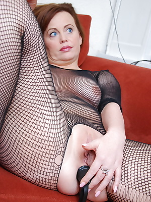 Dede, MILF slut housewife wearing a crotchless fishnet bodystocking enjoys masturbating and pushes in a black dildo sext