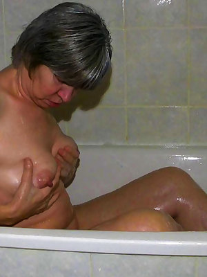 Naughty grandma taking a bath and perving