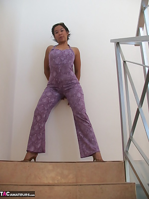 Asian girl Melissa was dressed in a violet overall where you see her nipples through. This sexy overall was close to the