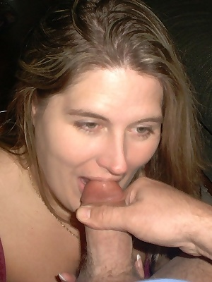 I'm giving hubby a blow job until he shoots on my tits.  It's a very domestic situation, nothing fancy - just two amateu