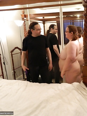 First, Carys is spread on the four-poster in her sexy lingerie and teased.Then later Carys is stripped and her tits are