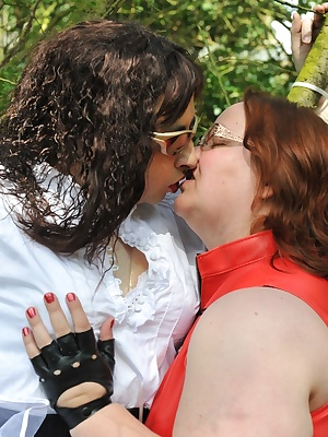 Seraphim, wearing corset, petticoat and gothic boots, is bound to a sturdy tree by Carys before she teases and gropes hi