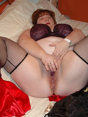 Here are some more photos of me stripping for you in my bedroom wearing my new purple 44g bra  matching purple lacy knic