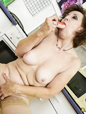 Older granny striptease in the kitchen and horny masturbation