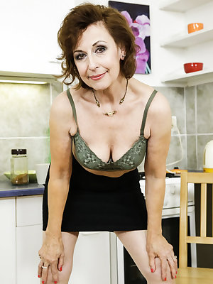 Old granny lady geting horny while making coffee in the kitchen