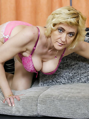 Blonde european lady pictured while stripping down