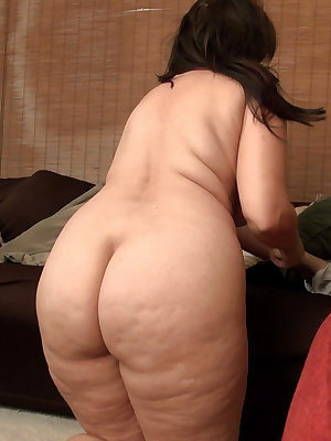 Curvy busty black haired mature stripping down and masturbating