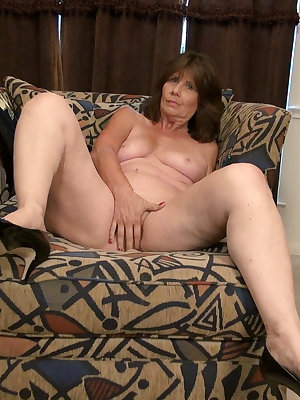 Mature granny taking advantage of armchair masturbation and toying