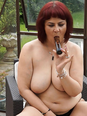 Old fat busty redhead masturbated her pussy with extraordinery toy