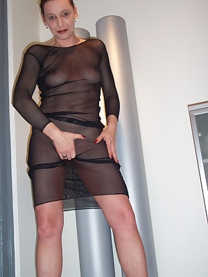 Taking of my black netdress for you and playing with my favourite vibrator.I had an imagination... I'm sitting on a hard