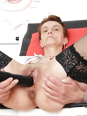 Rozi the granny plays with a gigantic black dildo and her old pussy