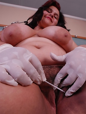 Buxom BBW model Karla posing as kinky nurse and letting big hooters loose