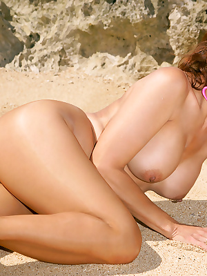 Mature lady in sun glasses Roni strips to nylon pantyhose on the beach