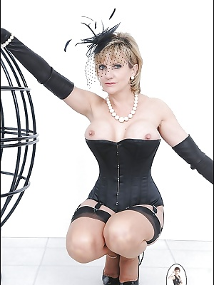 Busty mom Lady Sonia poses with naked boobies in her black stockings