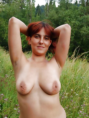 Naked busty wife showing off her priceless treasure
