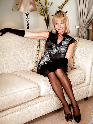 Glamorous mature blonde in nylons reveals her tits and honey pot