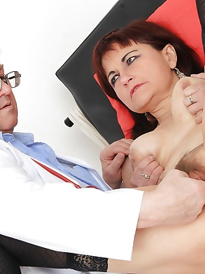 Older woman Remy strips down to underwear and stockings in doctor's office