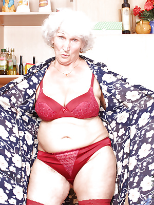 Naughty granny takes off her panties