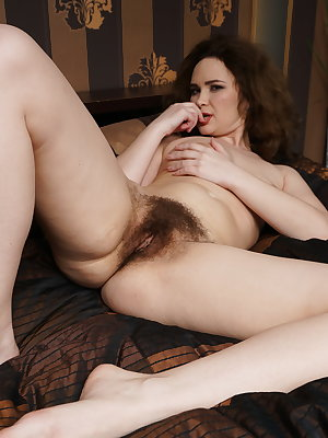 Extremely hairy housewife playing with her pussy