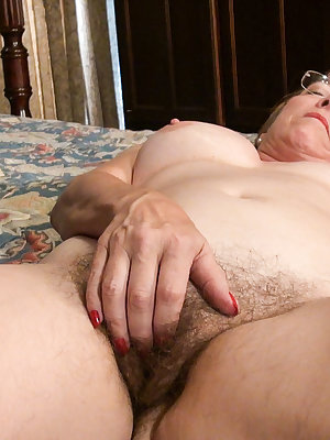 Hairy and wet is the pussy which belongs to this glasses wearing granny