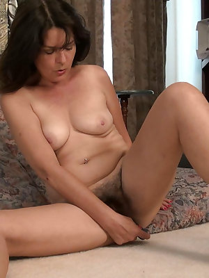 Horny mature woman toying her pussy alone