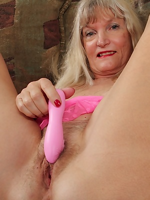 Mature blonde Lisa Cognee masturbates her hairy pussy with toys