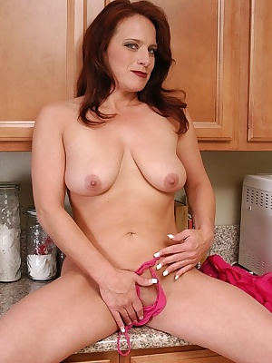 Older woman Tasia spreading her pink pussy lips in the kitchen