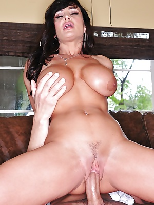 Busty mature brunette Lisa Ann giving handjob before hardcore sex