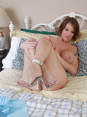 Older blonde babe Kayla plays with boobs and poses sexy feet