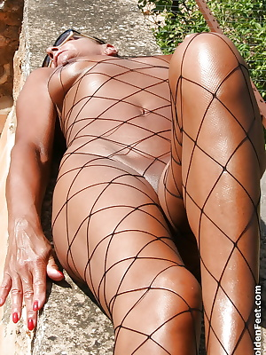 Mature English woman Lady Sarah and her pierced pussy poses outdoors