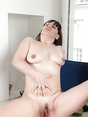 Chubby older woman Belta exposing saggy boobs while undressing