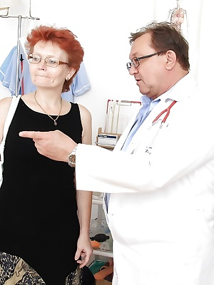 Redhead mature lady in glasses going through full gyno examinations
