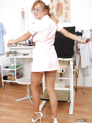 Mature girl Karen spreading that pussy in a nurse uniform