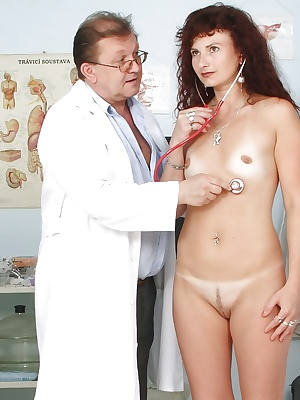 Stunning mature brunette with tiny tits toying her cunt after gyno exam