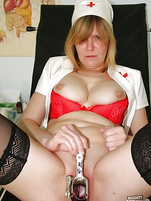 Bosomy mature nurse in black stockings toying her pink twat